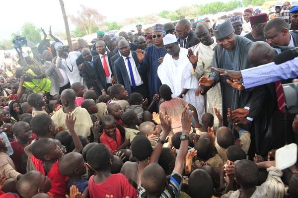 File: Ali Ndume and Saraki during a visit to IDP camps in Borno