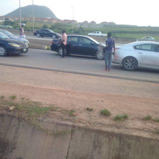 A Young man hawking cutlasses along Kubwa expressway