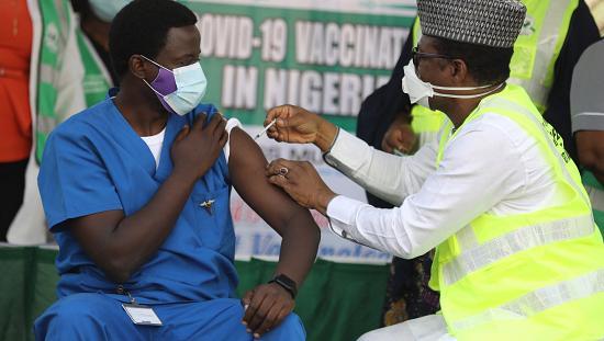 A frontline healthcare worker in Nigeria receiving the Oxford-AstraZeneca vaccine