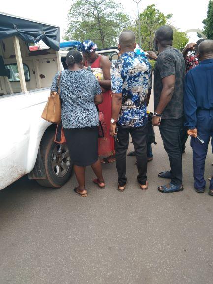 Leornard Onuchukwu and his wife entering the police van